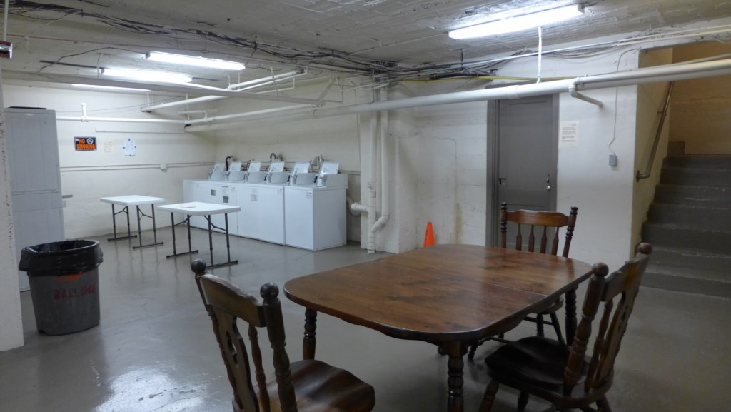 Large laundry room in basement. Use credit card for your wash and dry