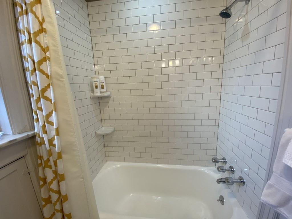 Take a shower, or soak in the Beckmann's bathtub.
