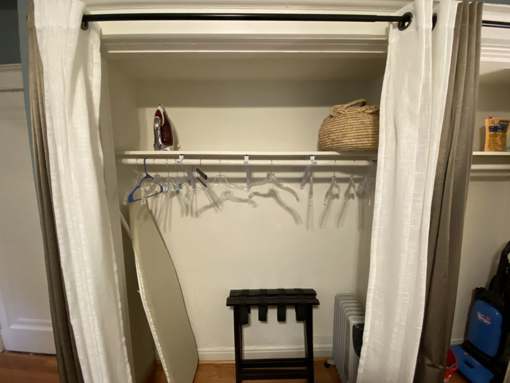 Large closet in the Bennett includes luggages racks, iron and ironing board.