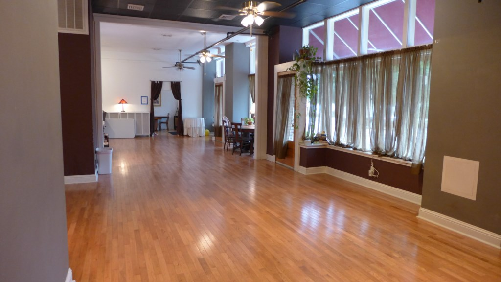 The main room is long and narrow, with hardwood flooring