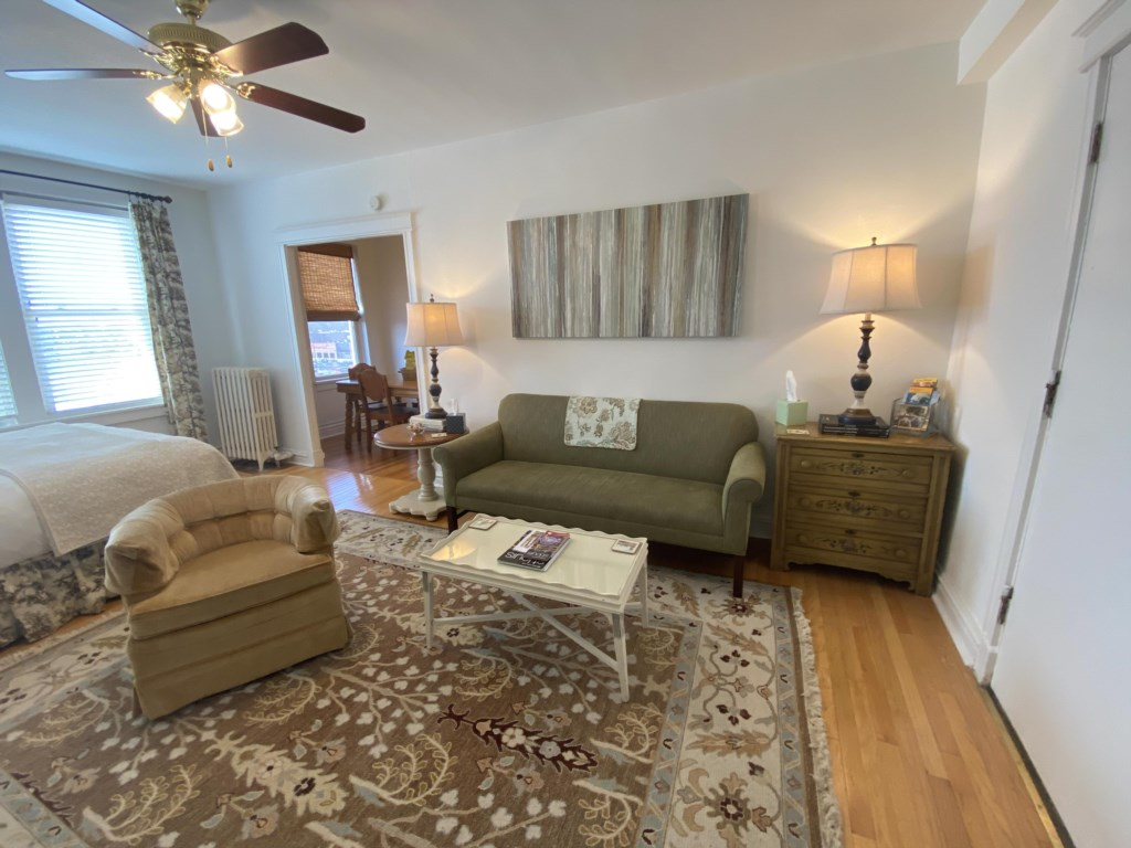 The Emma Sale Suite features a main large room, with both the living area and the bed.