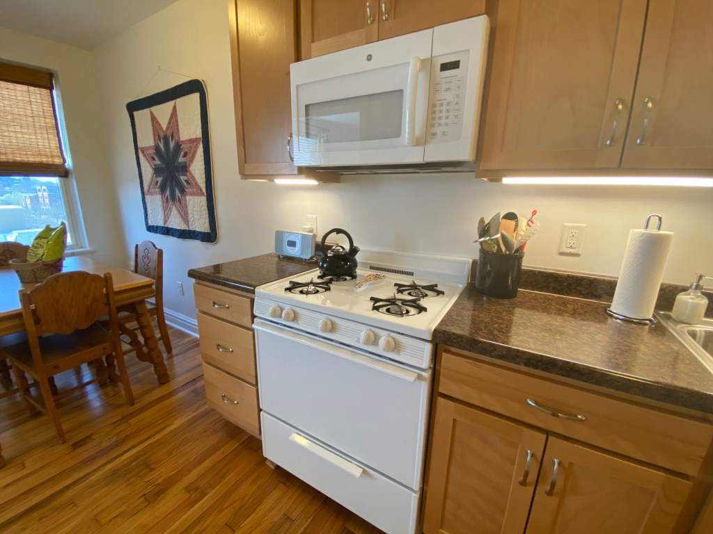 The Emma Sale Suite features both a large gas range and microwave.