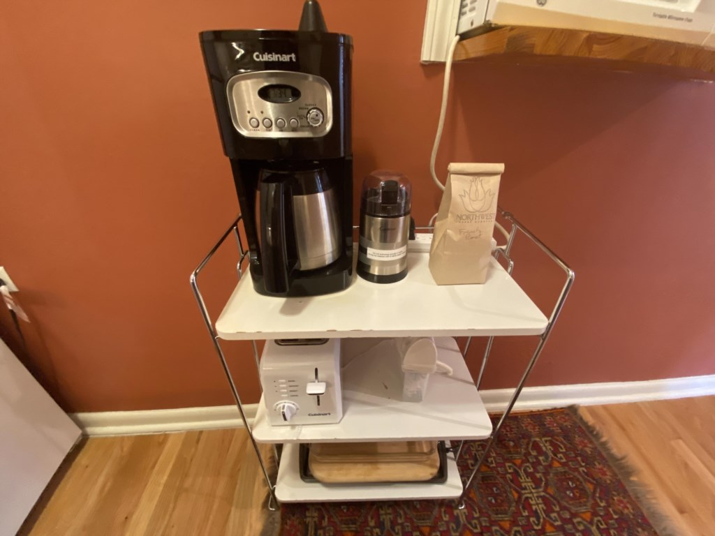 Coffee station, toaster, cutting boards and more are on this cart in the kitchen of the Jessie Benton Suite.