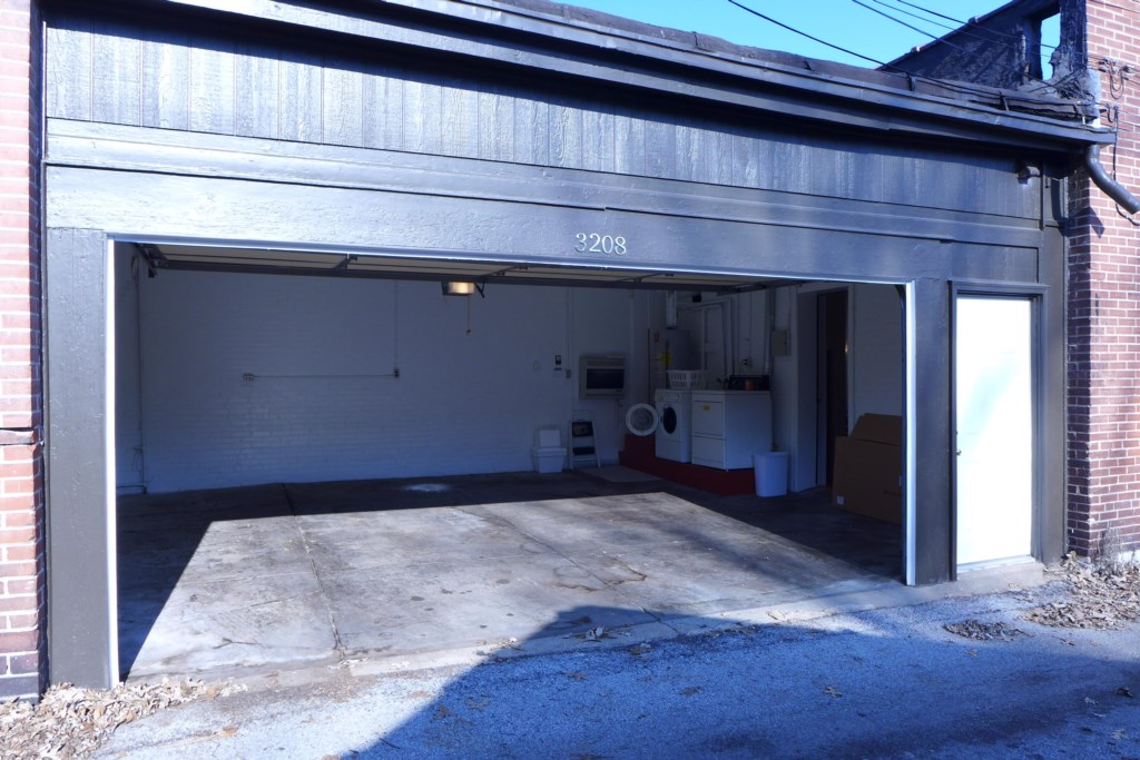 Oversized two-car garage. Washer and dryer are in garage
