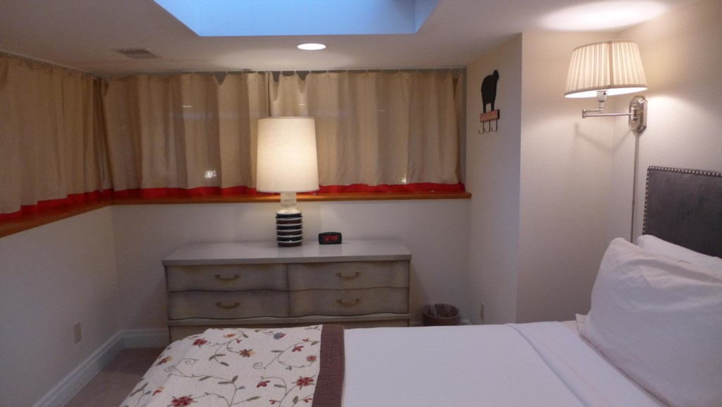 Loft bedroom has curtains for privacy