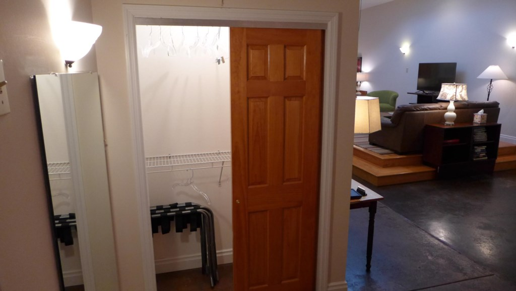 Two large closets in Loft, with luggage racks and hangers