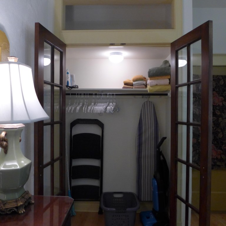 Luggage racks, and step ladder to easily store your suitcase in upper closet