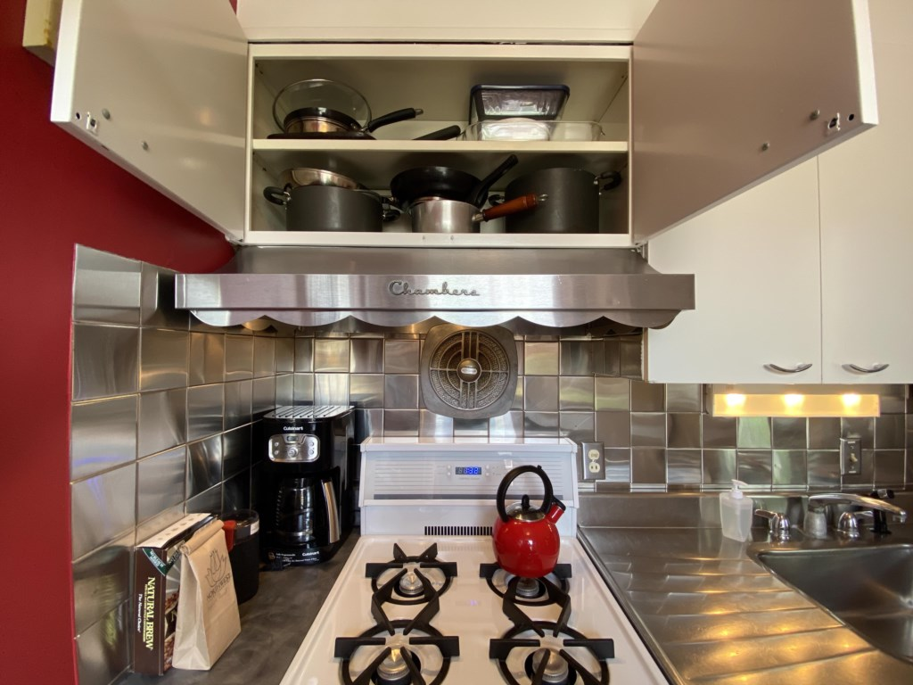 Pots and pans over the gas range.