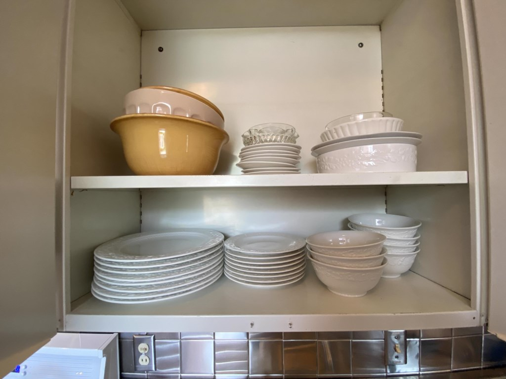 Dishes above the sink.