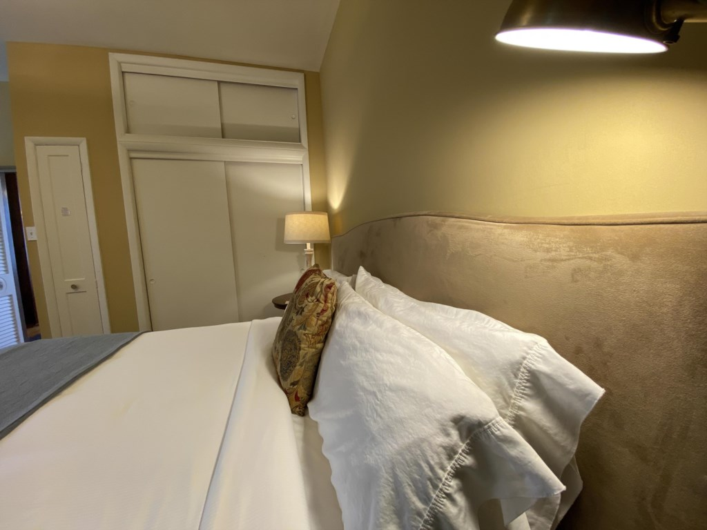 Sink into soft sheets, with thoughtful lighting on each side of the bed.