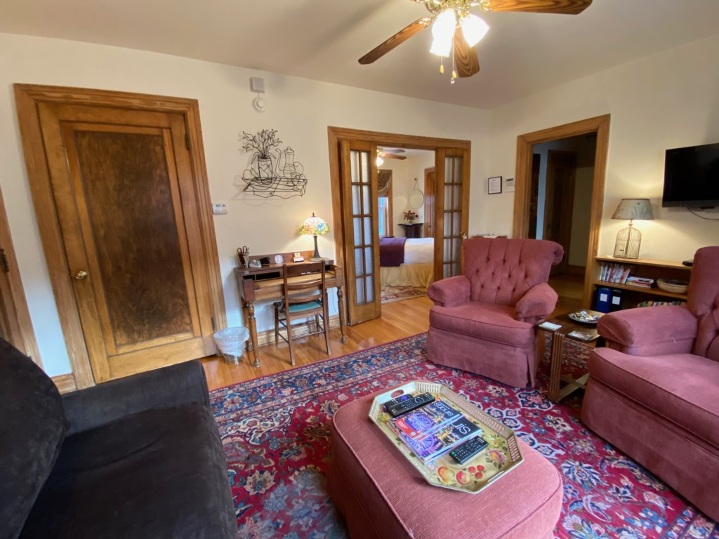 French doors provide privacy between living room and bedroom of Shaw Guest Suite.