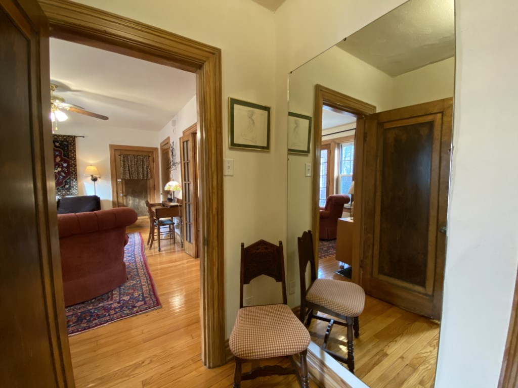 Dressing room of Shaw Guest Suite has full-length mirror.