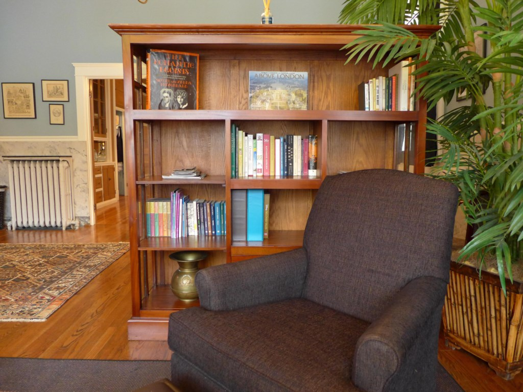 The King-sized bed in the Ullrich Suite is behind this bookcase.