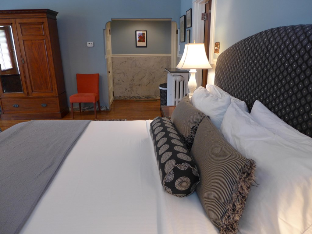 Sleep soundly wrapped in soft linens on the firm mattress. Reading lamps on each side of the bed in the Ullrich Suite.