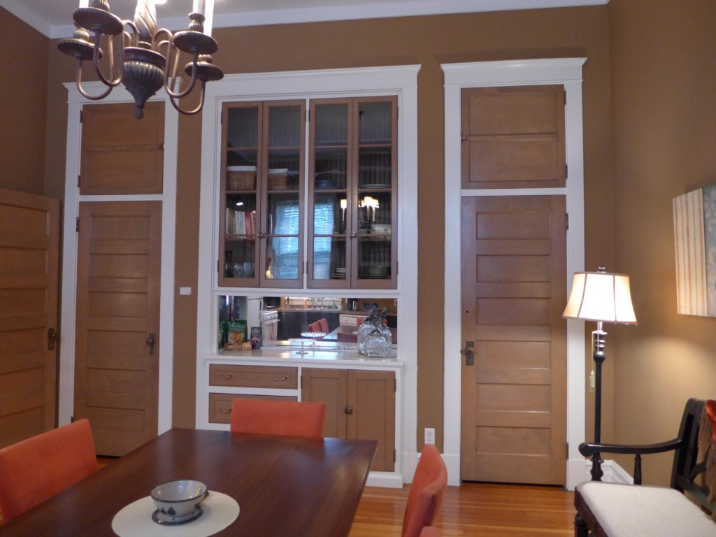 Original cabinetry and abundant storage space in the kitchen of the Ullrich Suite.