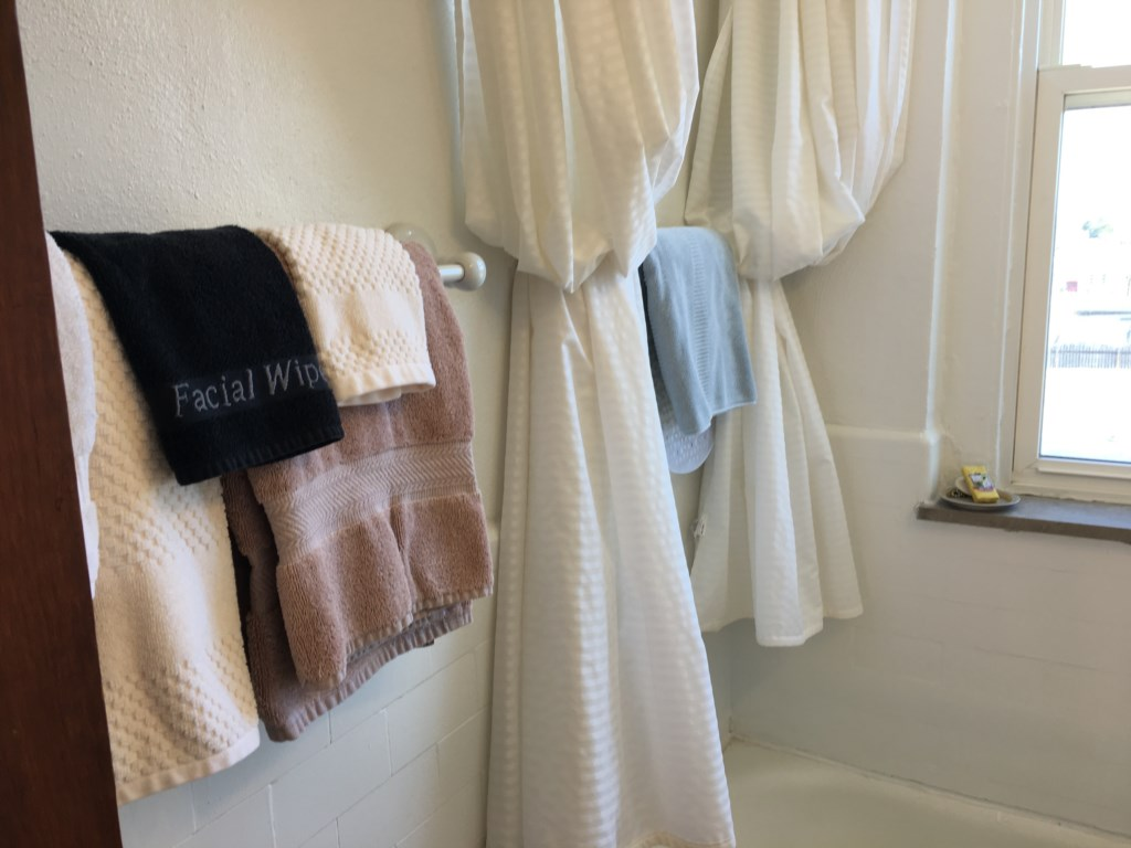 Fluffy towels and a black facial cloth for make-up removal.