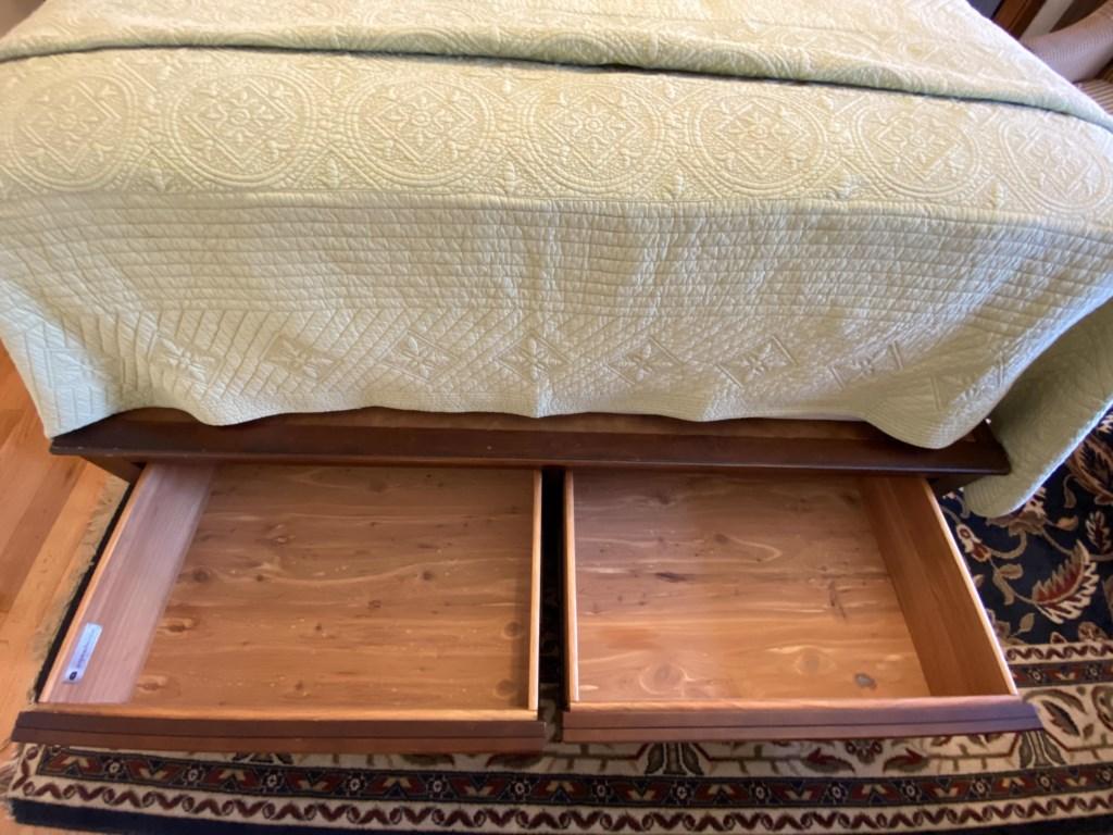 Cedar drawers built into bed frame.