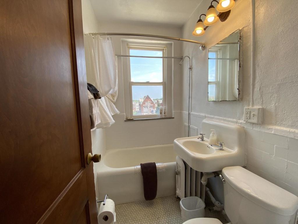 Bathroom has both tub and shower.