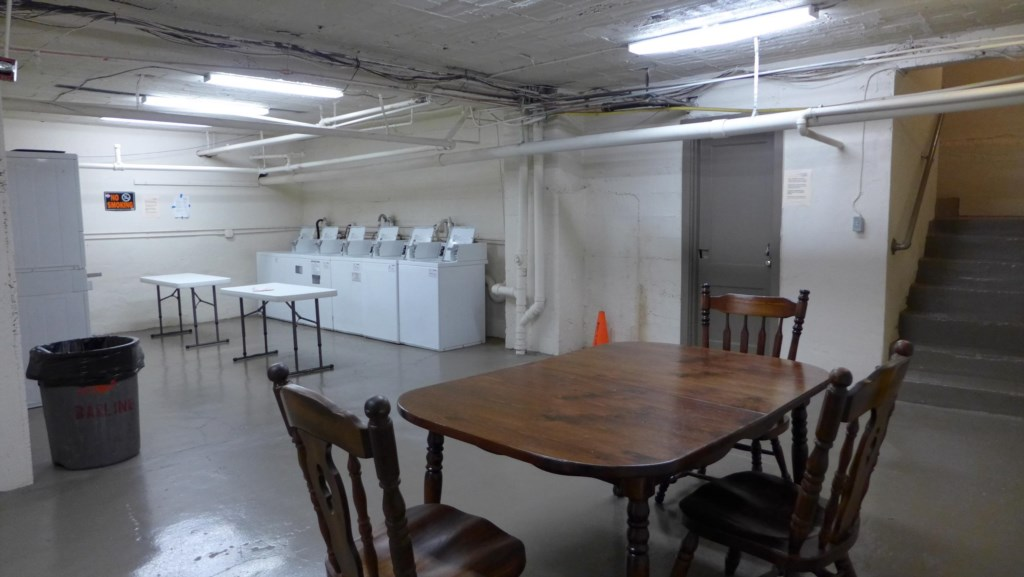 Laundry room is in the basement of the building.