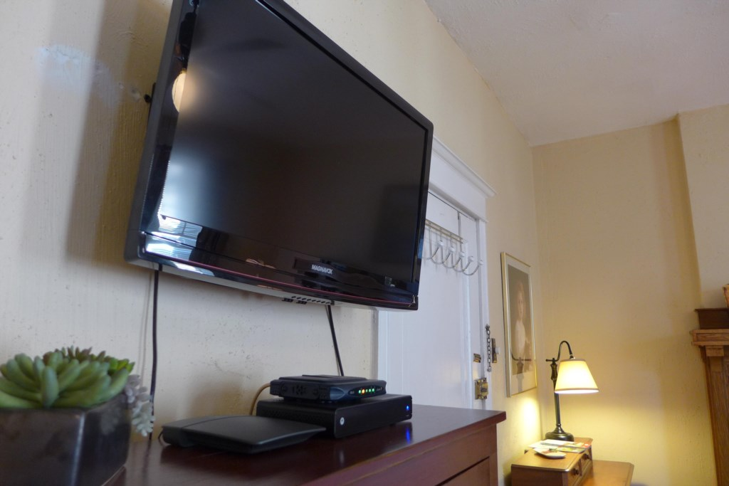 Flat screen television has antenna for local stations and Roku box for streaming channels.