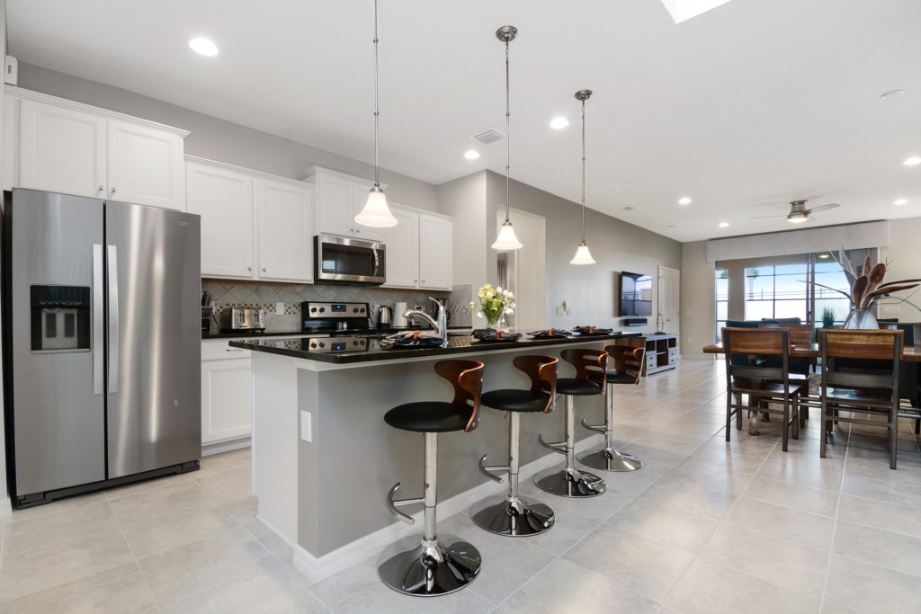 View 2 of beautful kitchen area with barstool seating