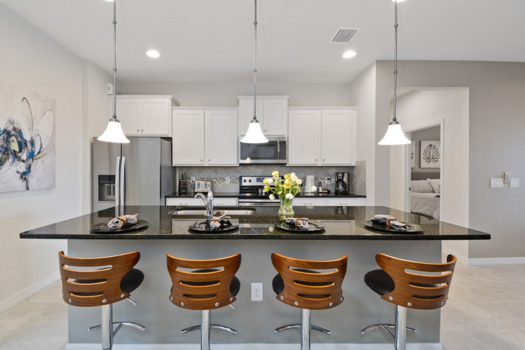 Beautiful kitchen area with barstool seating