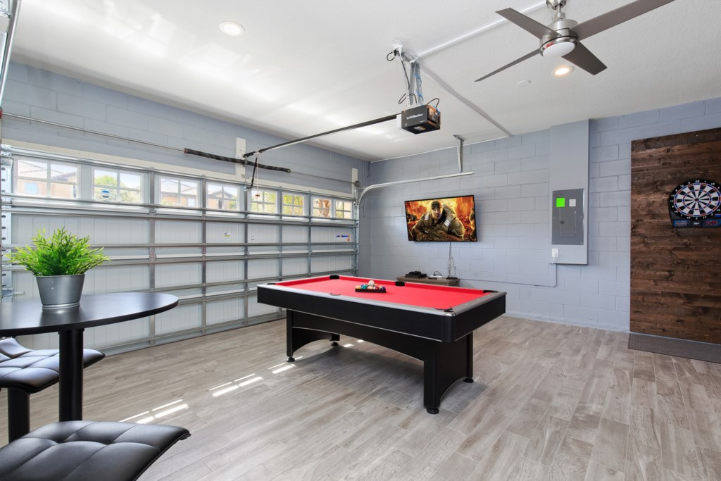 Fun game room with flat screen TV, pool table, and darts