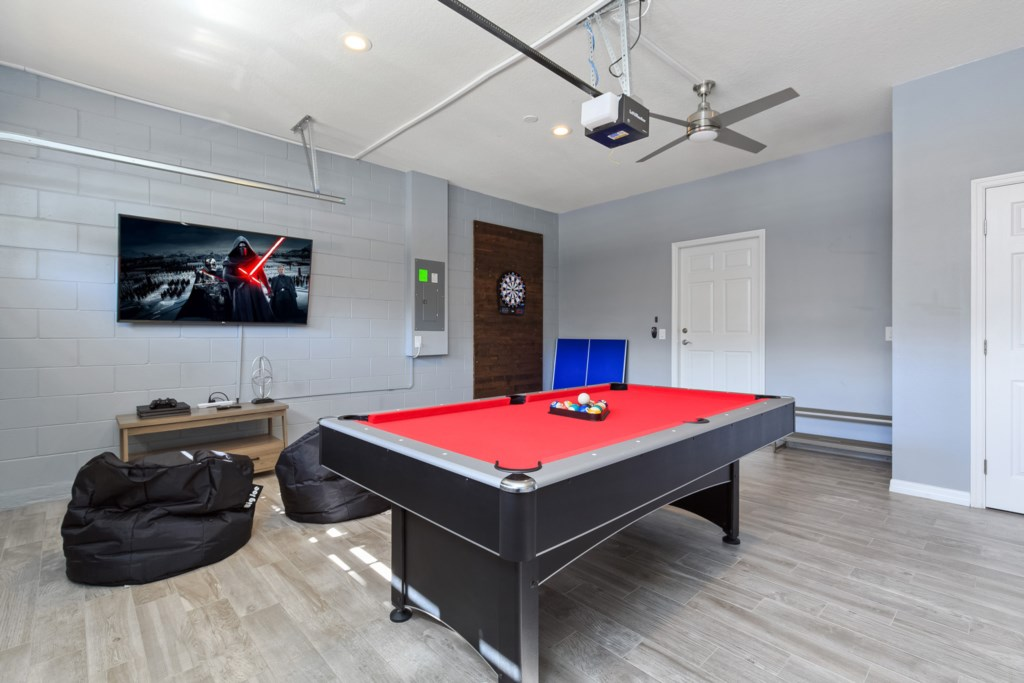 View 2 of fun game room with flat screen TV, pool table, and darts