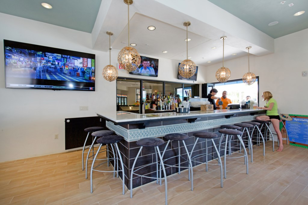 Windsor at Westside clubhouse bar area with flat screen TVs
