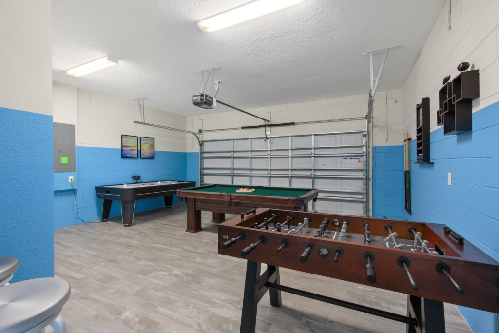 View 2 of awesome game room with foosball, air hockey, and pool tables