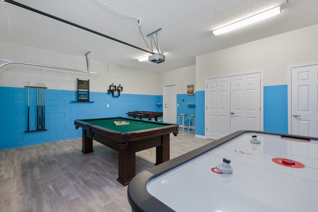 View 3 of awesome game room with foosball, air hockey, and pool tables