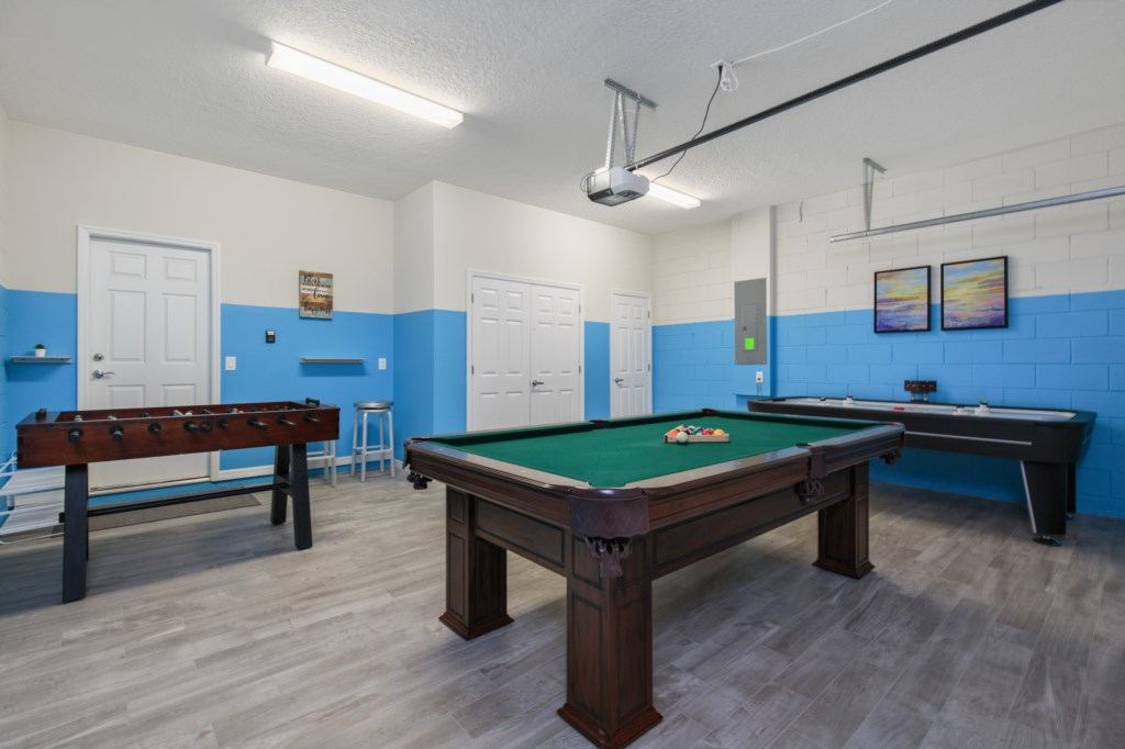 Awesome game room with foosball, air hockey, and pool tables