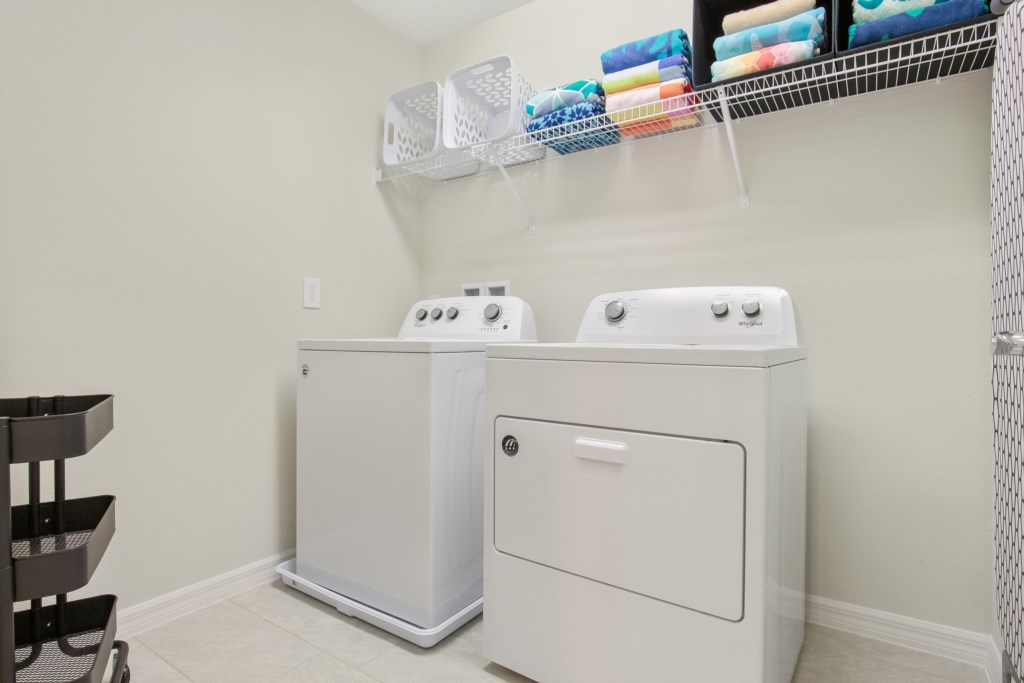 Laundry room with full size washer and dryer and laundry baskets