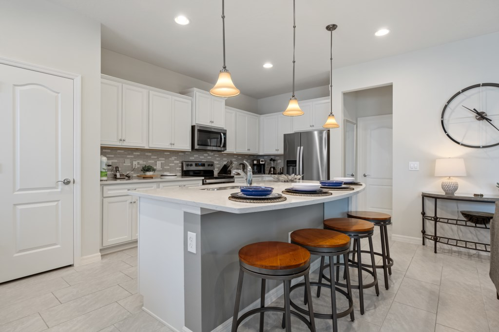 View 2 of modern style kitchen with barstool seating