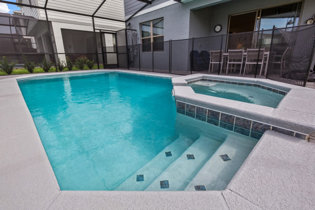 View 3 of luxurious pool and spa with pool safety fence
