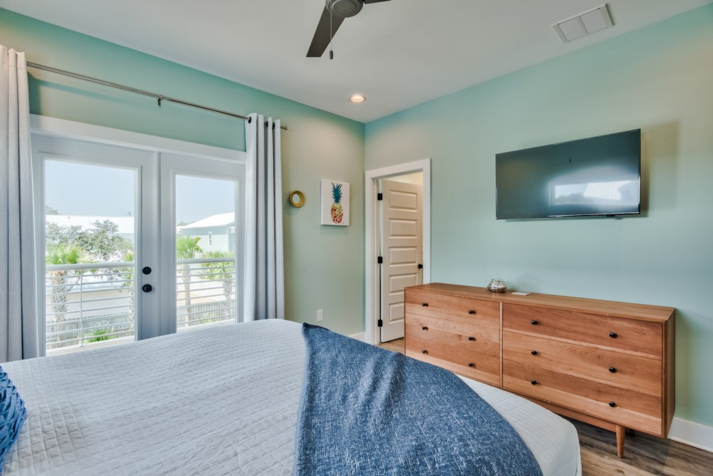 Spacious Bedroom with storage, TV and Balcony access