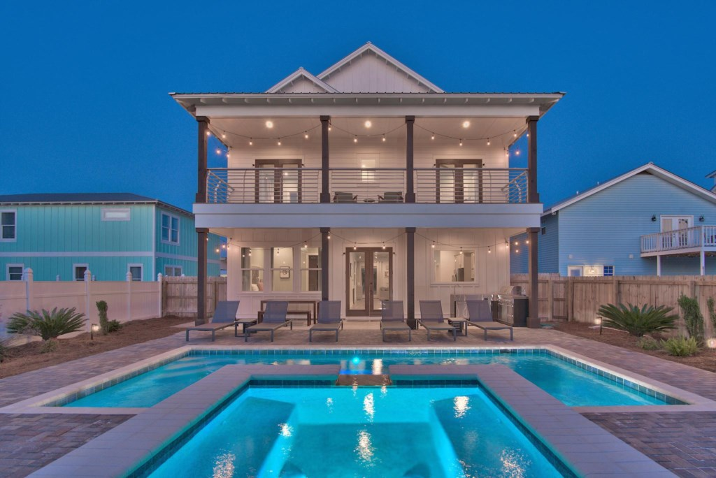 Spacious pool area with outdoor lights