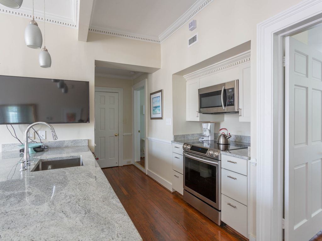 Fully equipped kitchen with sleek granite counter.
