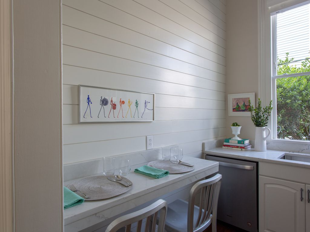 Counter seating for 2, lovely shiplap wall and art