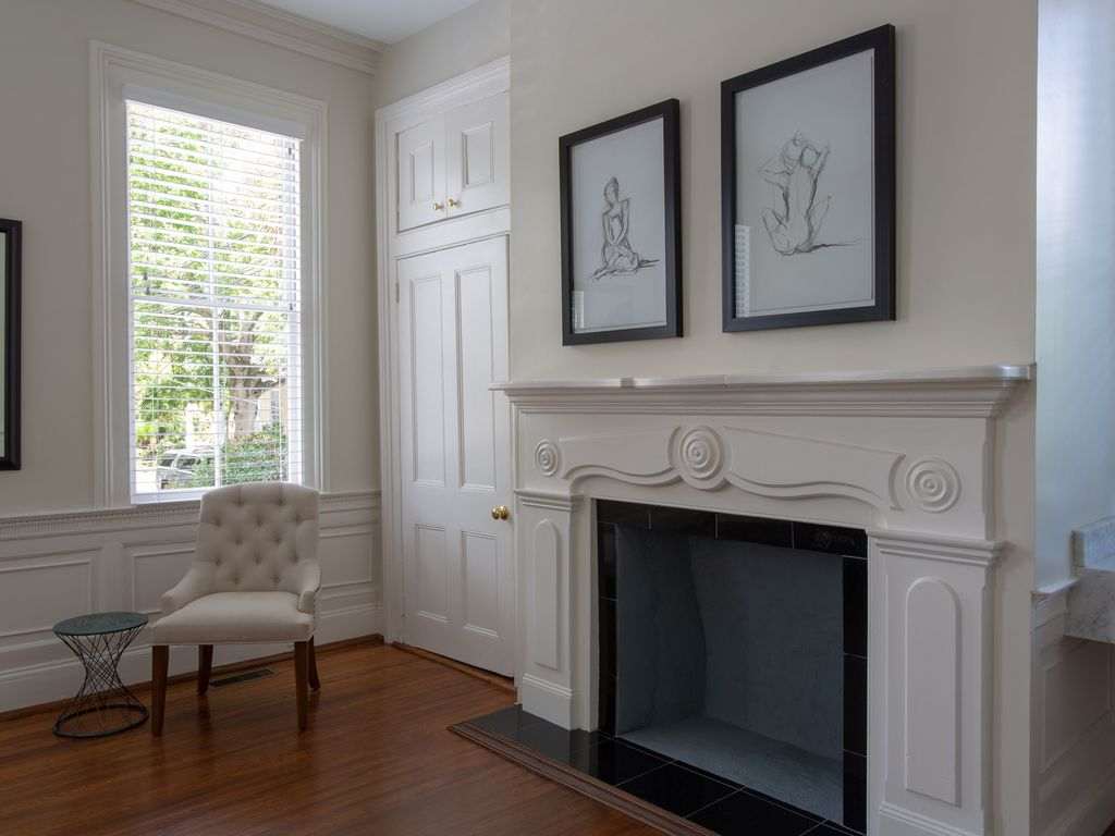Master bedroom fireplace and view of St Philip Street