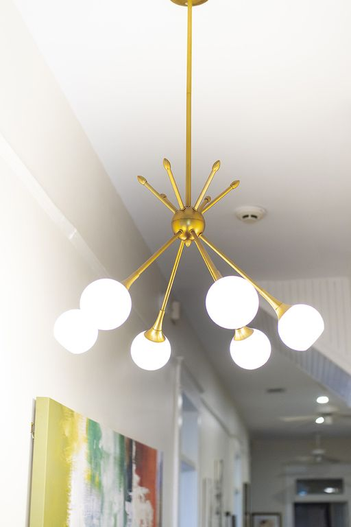 Mid-century chandelier in hall.