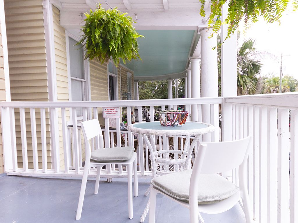 Porch looking south. Table for 2 - 4. Chairs interchange with dining chairs.