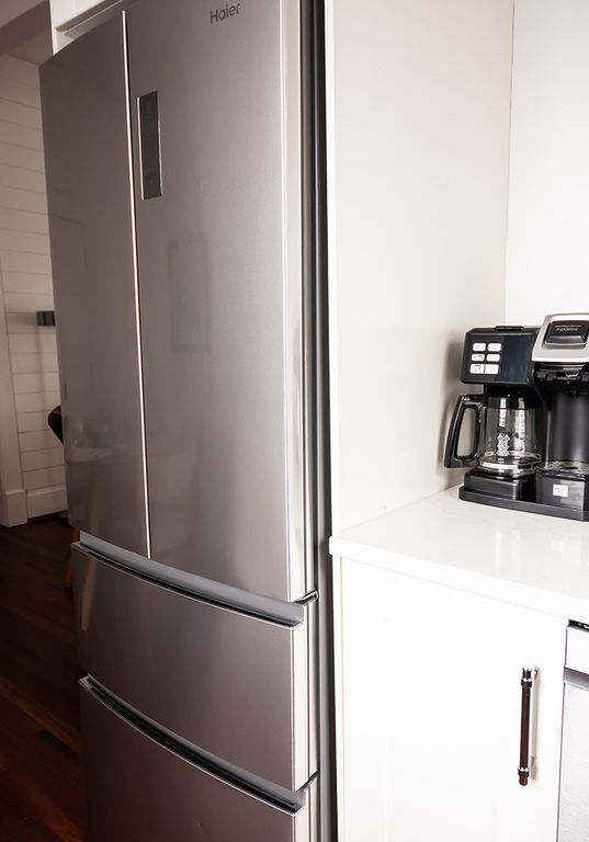 French door refrigerator with double door freezer.