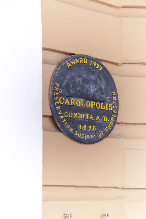 Coveted Carolopolis award given by the Preservation Society to the owner.