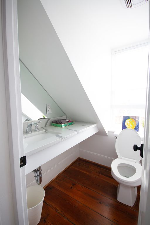 "East dormer ""water closet"" with large mirror and marble counter"