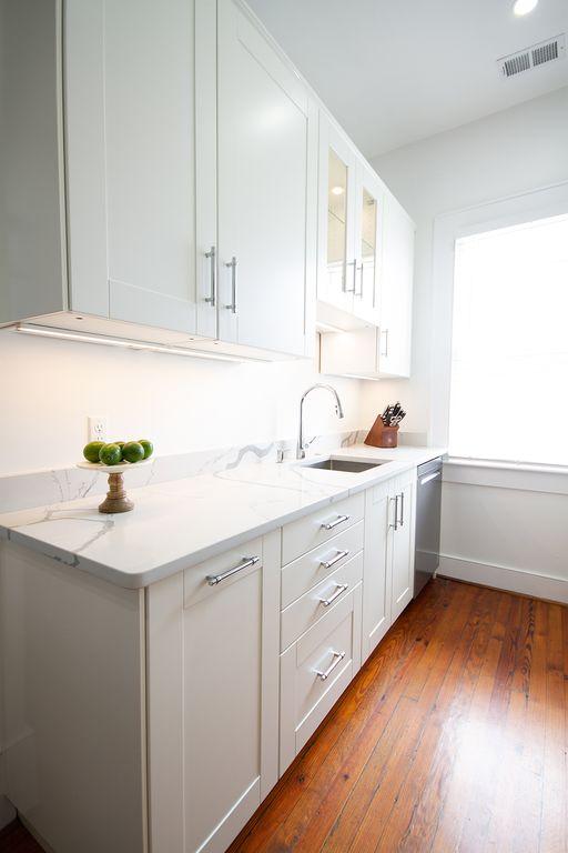 Bright, well organized kitchen.