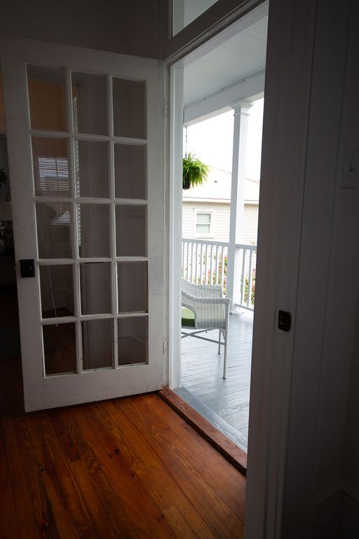 Looking from wet bar to porch.