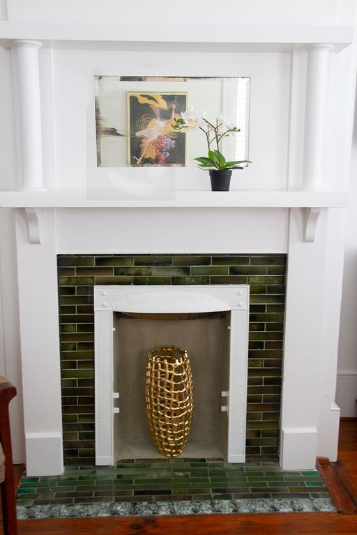 Original tile in non-working fireplace.