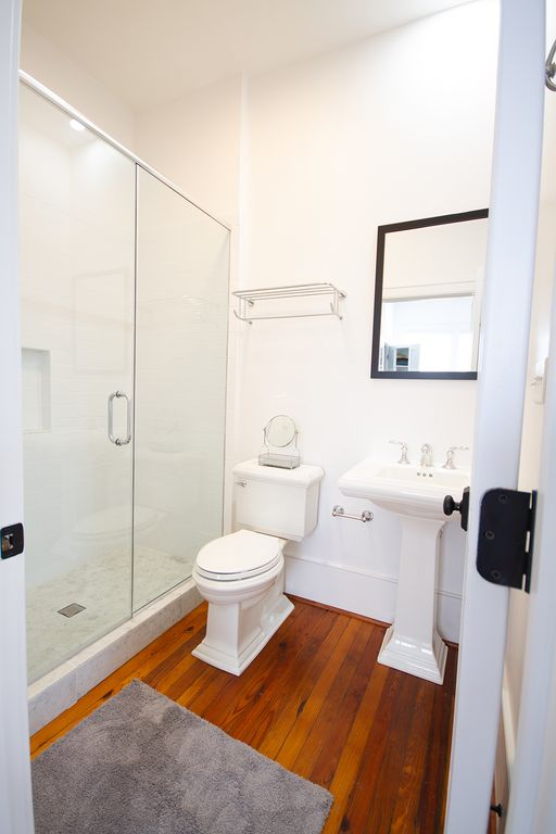 Bath (1) with glass door shower en-suite for front porch bedroom.