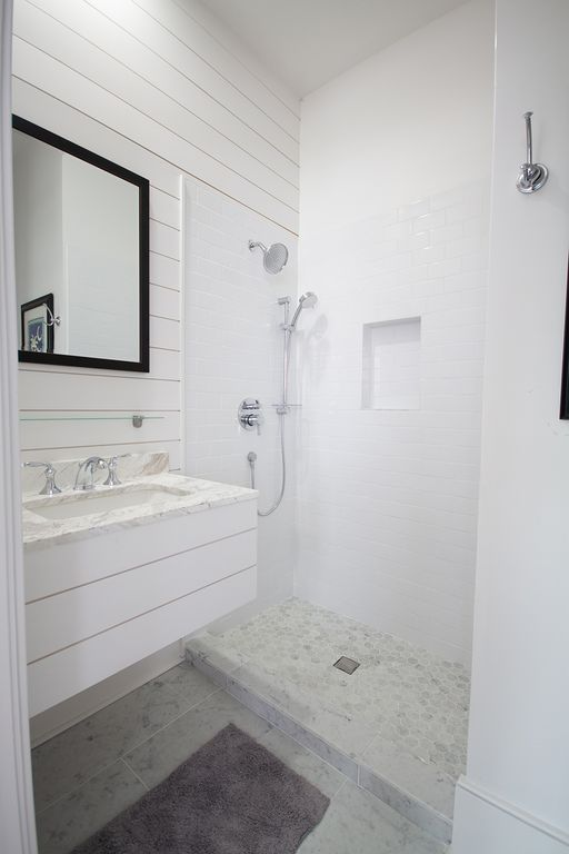 En-suite bathroom 4 with shiplap and marble for back room.